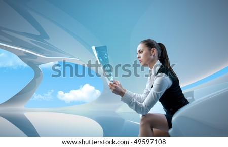Sexy businesswoman examining future digital report / newspaper (outstanding business people in interiors / interfaces series)