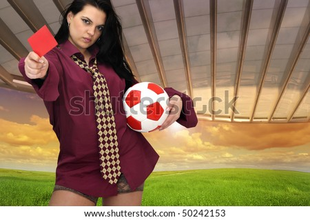 Sexy businesswomen with soccer ball