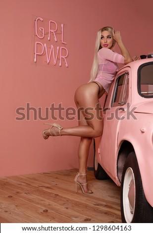 sexy butt girls in underwear on pink background.