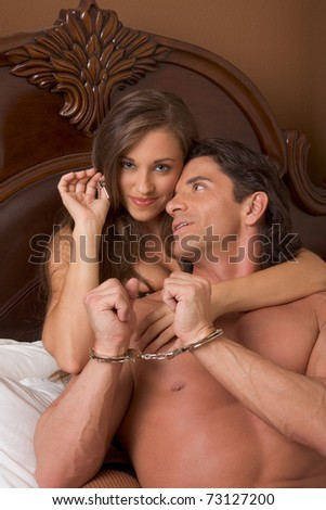 Sexy Caucasian couple in love sexual games, man in handcuffs