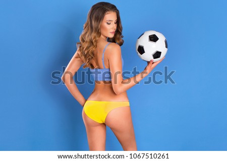 Sexy cheerleader with a soccer ball #1067510261
