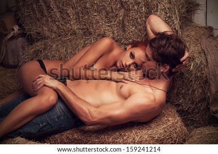 Sexy couple hugging. While laying nude in hayloft