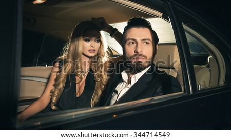 Sexy couple in the car. Focus on man