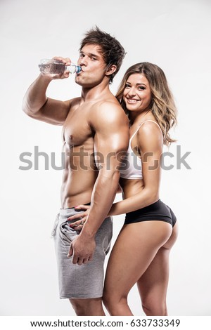 sexy couple, muscular man with a beautiful fitness woman isolated on a white background #633733349
