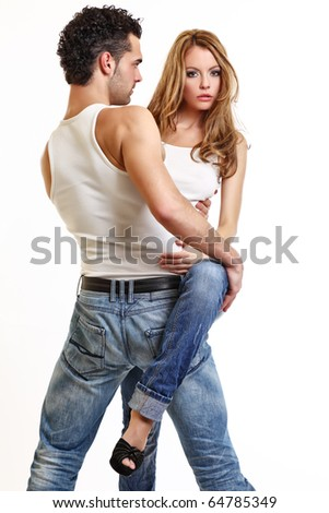 sexy couple posing on white background