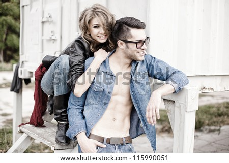 sexy couple wearing jeans and boots smiling natural - retro processed image