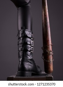 Stock photo of a sexy female assassin detail of boot and bat.