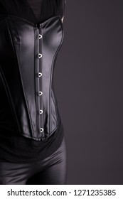 Stock photo of a sexy female assassin wearing black leather.