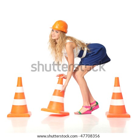 Sexy female construction worker with orange cones