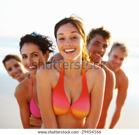 stock photo : Sexy female in a bikini with friends at her back