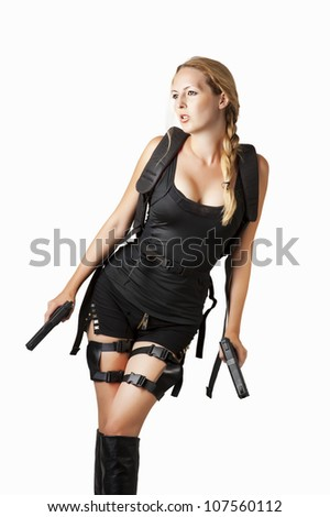 Sexy female model with backpack, two hand guns and with braided hair