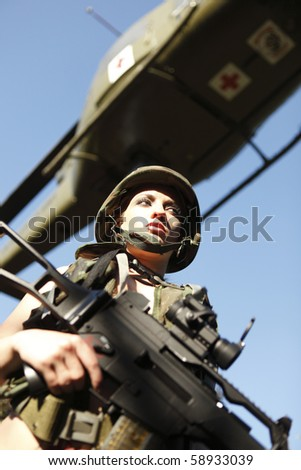 Sexy female soldier with an assault rifle.