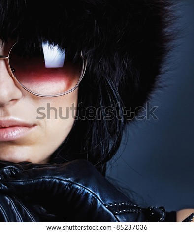 Sexy female wearing leather gloves and sunglasses