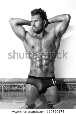 Sexy fine art black and white portrait of a very muscular male model  in swimsuit