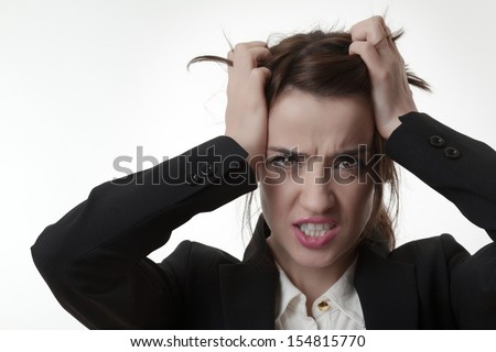 sexy frustrated woman office worker pulling out her hair not very happy