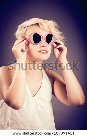 sexy girl in retro style is posing with sunglasses - stock photo