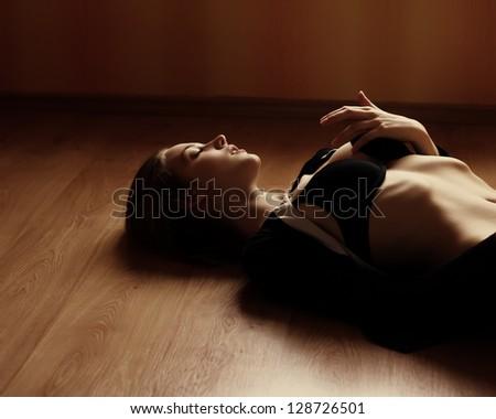 Sexy girl in underwear lying on the floor