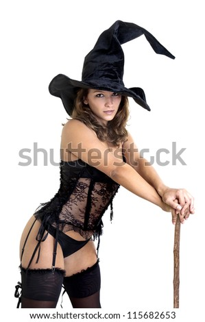 Sexy girl in witch costume isolated in white