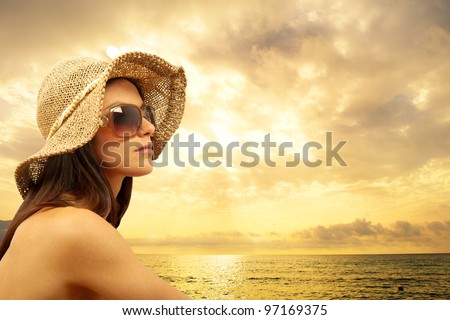 Sexy girl on the beach during sunset