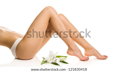 Sexy girl shows slender legs with a flower