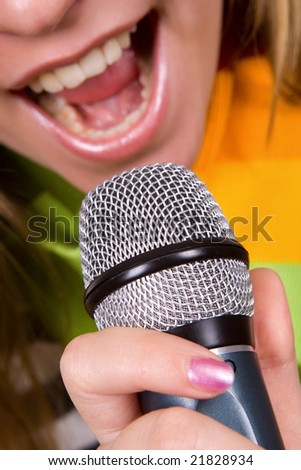 Sexy girl singing in microphone