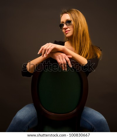 sexy girl sitting on a chair