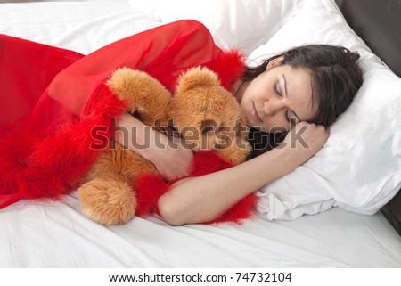 Sexy girl sleeps with teddy bear