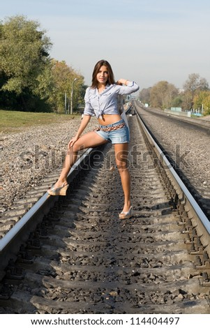 Sexy girl standing on rails