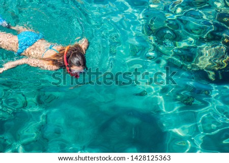 sexy girl swimming and snorkeling in Red sea beautiful aquamarine water exotic natural environment, enjoy in summer cruise vacation time concept picture with empty copy space for text #1428125363