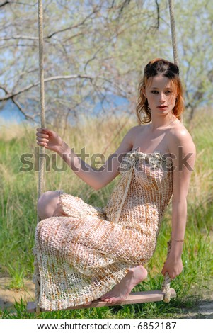 Sexy girl wearing in fishing net on a swing stock photo for Girls fishing naked