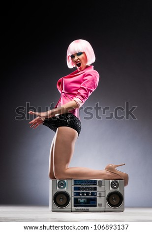 Sexy girl with a tape recorder