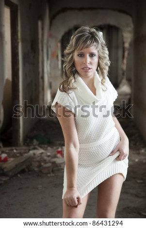 Sexy girl with expression of fear in abandoned building - stock photo