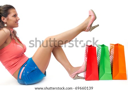 Sexy girl with her shopping bags on an isolated white background