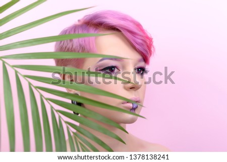 Sexy girl with short hair. Portrait of a woman with bright colored hair, all shades of pink. Beautiful lips and makeup. Professional coloring. professional makeup.