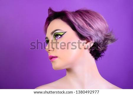 Sexy girl with short hair. Portrait of a woman with bright colored hair, all shades of purple. Beautiful lips and makeup. Professional coloring. professional makeup.