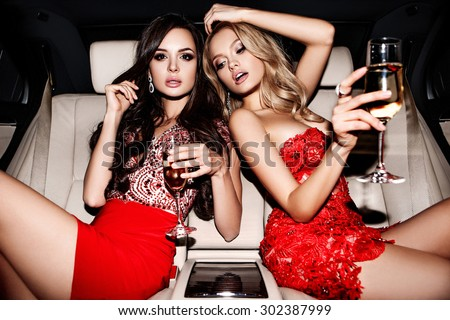 Sexy girls in the car.  Celebrating. - Shutterstock ID 302387999