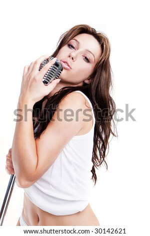 sexy glamour pop star singer with white lingerie and retro microphone - stock photo