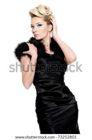 Sexy glamour woman in black dress with fur and modern  hairstyle,  on white background