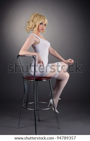 Sexy gold blond woman sit on bar chair