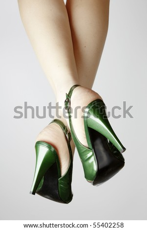 Sexy green leather high heels stilettos shoes and womens legs
