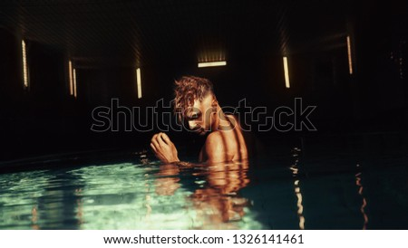 Sexy guy in the water.The guy in the pool