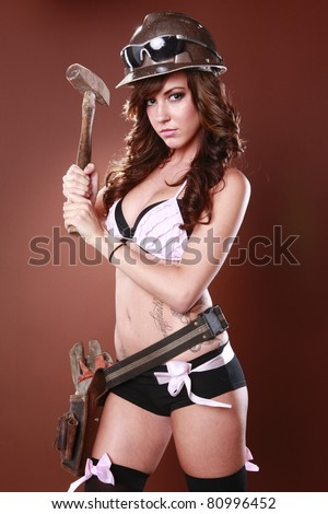 Sexy handyman is going to fix it all - stock photo