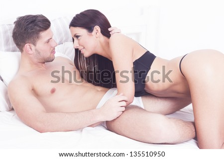 Sexy heterosexual passion couple on the bed
