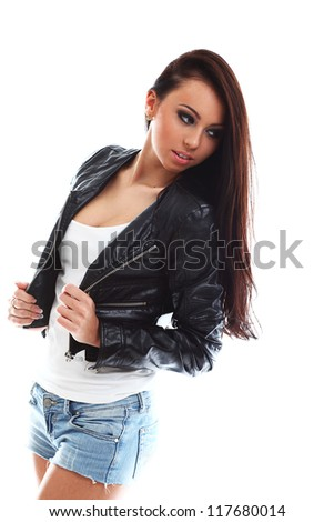 Sexy, hot and seductive woman with desire in eyes wearing short jeans