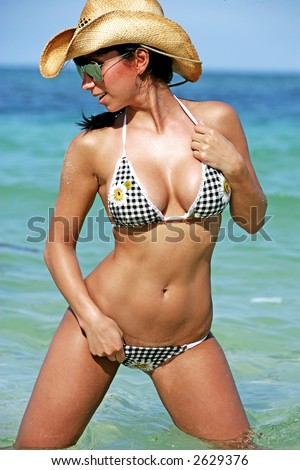 stock photo : sexy hot bikini babe in a cowboy hat. Save to a lightbox ▼