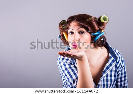 sexy housewife with curlers. pin up portrait