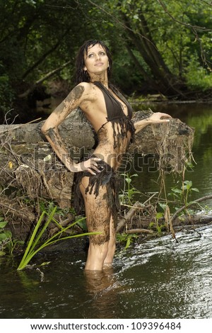 Sexy lady posing with a loincloth on the nature