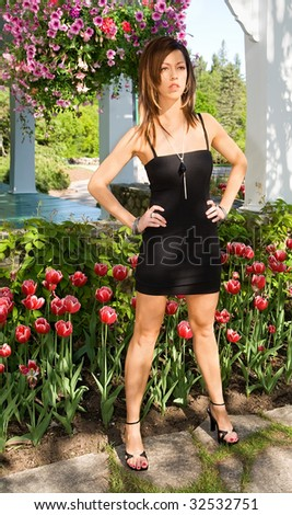 Sexy Lady Standing in Front of Tulips
