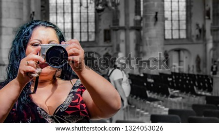 Sexy latin mexican woman with long black hair taking a picture inside a church through a mirror, reflecting a man looking at the altar with a black background in Rotterdam in the Netherlands