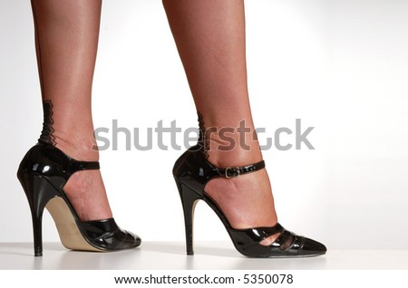 stock photo sexy legs in black seamed stockings decorative heel black patent stiletto high heel shoes 5350078 Boy earns an A plus by spreading his ass for gay prof.